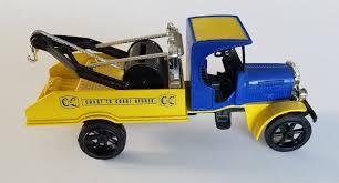 100 Kenworth Tow Truck 1925 ERTL Diecast 1 34 Scale Coast To Coast Stores MIB