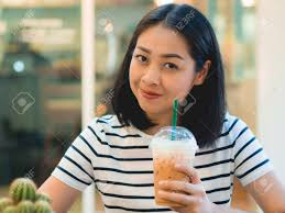Asian Woman Drink Iced Coffee In The Cafe Stock Photo
