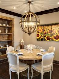 Appealing Rustic Round Dining Table With White Chairs And Wood Shelves Also Chandelier Flower Wall