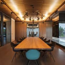 Minimalist Medium Tone Wood Floor And Brown Dining Room Photo In San Francisco With