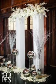 Contemporary White pillars floral bridge glass spheres candles