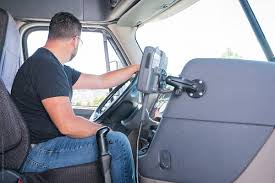 100 Gps For Truck Drivers Driver Using GPS Stocksy United