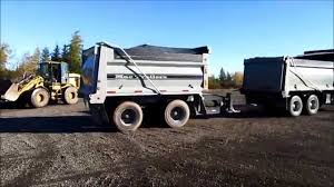 Dumping Tandem & Pup Trailer - YouTube