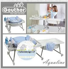 table à langer et baignoire adaptable sur une baignoire bébé