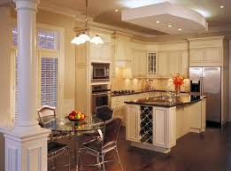 A Large Island Centers This Kitchen Over Dark Hardwood Flooring With Sleek Black Countertop
