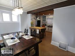 An Overhead Beam In Open Floor Plan Designs Helps Demarcate Two Rooms