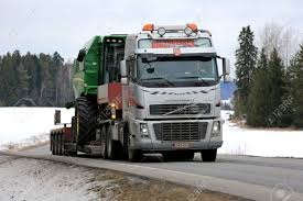 SALO, FINLAND - MARCH 4, 2016: Volvo FH16 Truck Hauls John Deere ... Tomy John Deere Carstrucks Plastic Ace Hdware 150th High Detail 460e Adt Articulated Dump Truck Toys Diecast With Skidsteer At Toystop Antique Tractor On Transport Flatbed Truck Florida Stock New Eseries Features North Americas Largest Ertl 118 Tractor Dodge 2500 V10 Dealer Pickup Farm Shop Ertl Gator Mega Hauling Set Free Shipping Salo Finland March 4 2016 Volvo Hauls W330 1955 Ford F100 Louisville Showroom Bangshiftcom Brian Lohnes Weve Found Your Perfect Peterbilt Rolloff 4020