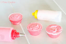 Now take next color and carefully pipe a line on top of batter Be careful not to pipe into bottom layer of batter but to squeeze out second color on top
