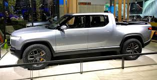 100 Truck Bed Motorcycle Lift Closer Look At Rivians R1T Allelectric Pickup Truck And
