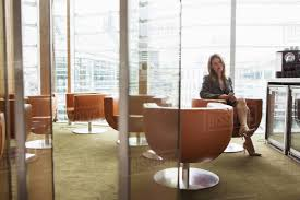 Businesswoman In Coffee Area Office London UK