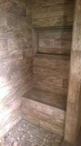master shower with bench and window for soap shoo river rock
