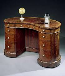 A VICTORIAN MAHOGANY KIDNEY SHAPED DESK BY GILLOWS OF LANCASTER