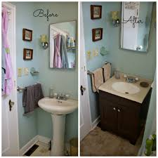 bathroom blue paint wall with vanity sconces and black glacier