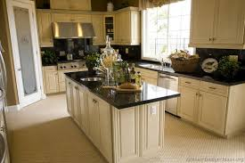 White Kitchen With Black Appliances Best Off Cabinets Dark Floors Ceramic Countertop Gas Range Hood Cailing Light Oven Refrigerator