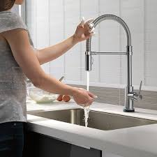 Delta Touch Faucet Battery Location by Delta Trinsic Pro Spring Spout Kitchen Faucet Arctic Stainless
