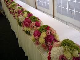 Colorful Spring Wedding Flower Arrangements On Long White Table Decoration Combined With Lovely Roses
