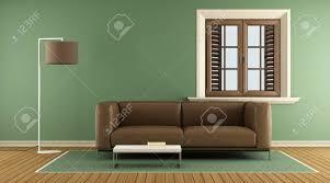 moderne grüne wohnzimmer mit braunen sofa und holzfenster 3d rendering