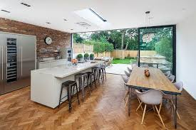 View In Gallery Herringbone Pattern Flooring And Brick Wall Backsplash The Modern Kitchen Design Concept 8