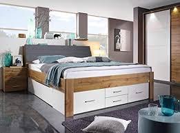 lifestyle4living funktionsbett in wotan eiche dekor und weiß 180x200 cm doppelbett mit stauraum kopfteil und schubladen