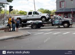 Tow Truck At Accident Scene Stock Photo: 73404952 - Alamy Tow Truck Driver Cheats Death Dodges Skidding Car In Crazy Crash A Smashed Up Charter Bus Being Towed By A After Highway Blured Police Department Accident Stock Photo Royalty How To Get Paid Rates When Aaa Is Involved Company Towtruck Killed School Youtube Towing 131tow T Bone With Painful Extrication 62nd Pacific Milwaukee Service 4143762107 Hauling Away Passenger After Traffic Between Bike And Tow Truck Towing Accident Rollover Crash Remorquage Lapd Nicb Warn Of Bandit Scams
