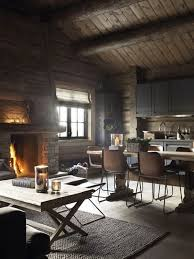 Rustic Cabin With Open Kitchen Living Room And Dining Creates A Comfortable Space For Conversations Near The Fire