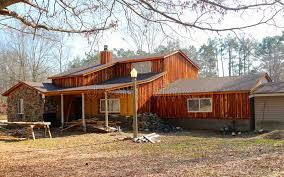Download Ranch Style Home With Rustic Wood Siding Stock Image
