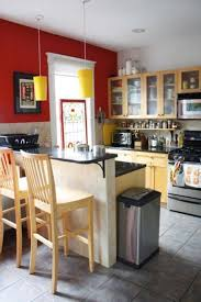 modern small kitchen with red wall decor wooden bar stool black