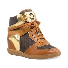 michael kors nikko high top wedge sneakers in brown lyst