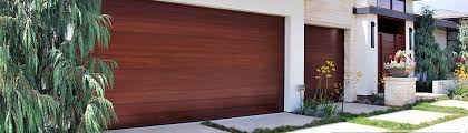 Tuscan Garage Door and Automatic Out Swing Carriage Doors Made in