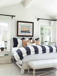 Example Of A Coastal Master Carpeted Bedroom Design In Orange County With White Walls