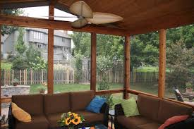 Rustic Unfinished Wood Sunroom Interior Scheme With Hand Made Rattan Sofa And Comfy Fabrics