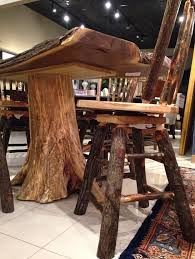 Incorporate This Solid Wood Table And Chairs Into Your Dining Room To Achieve A Charming Rustic Style