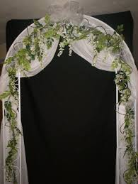 Elegant Indoor Wedding Arch Decoration With White Iron And Drapery Seasonal Beautiful Pictures Of Decorated Arches