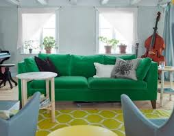 A Bold Green Velvet Stockholm Sofa Adds Colorful Touch To The Space