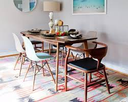 Dining Room With A Mid Century Modern Table And Boho Rug