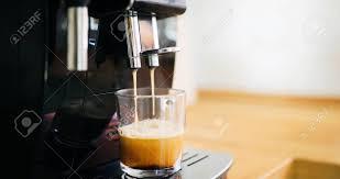Coffee Machine Making In Morning With Crema Stock Photo