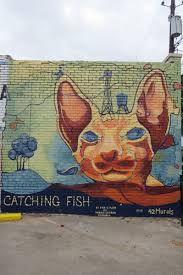 dan colcer catching fish 42 murals