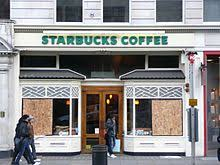 A Store On Piccadilly With Its Windows Boarded Up After Being Smashed By Protesters