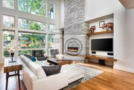schönes wohnzimmer mit parkettboden und kamin in neuem luxushaus poster myloview