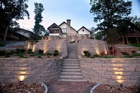 terraced retaining wall with stairs and accent lighting regarding