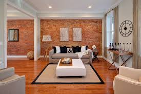 Creative Interior Design With Stunning Exposed Brick Wallpaper Fabric Sofa And Tripod Standing Floor Lamp