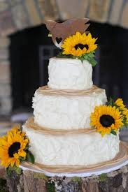 White Rustic Wedding Cake With Fresh Sunflowers