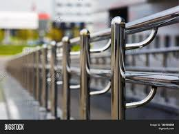 Chromium Metal Fence Handrail. Image & Photo | Bigstock Wall Mounted Metal Handrails Handrails Pinterest Lovable Pine Wood Natural Polished Curved Open Staircase With Best 25 Stair Spindles Ideas On Iron Railing Wooden With Bars Indoor Chrome Mobirolo Incridible Chrome Railing Banister Oak Steps As Modern Twisted Of Sacramento Stair Richard Burbidge Mmwecs Fusion Handrail End Cap Awesome Glass And Stainless Steel The Mopstick In White Hemlock More Fabulous Simplistic Stairs Style Bracket Crisp Details For