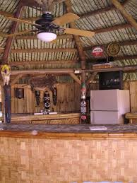 Wonderful Outdoor Kitchen Tiki Bar With Ceiling Lighting And Fan Combined Rustic Wood
