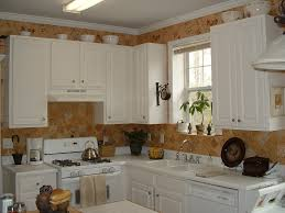 decorating above kitchen cabinets brown counter recessed