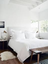 White Bedroom Featuring A Canvas Headboard Linens Wooden And Twine Bench Bronze Lighting The Kinfolk Home
