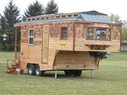This Adorable Travel Trailers Wood Siding Is Handmade And Will Only Get Better