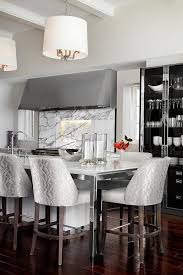 kitchen island with stainless steel legs and white drum light