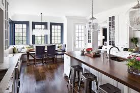 Open Kitchen Design With Custom White Cabinets And Banquette In Breakast Room