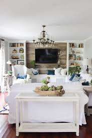 Rustic Farmhouse Living Room With Pops Of Teal And Green
